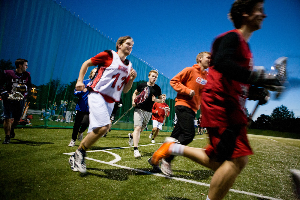 The lacrosse team at  the Norwegian University College in Oslo warming up before practice.