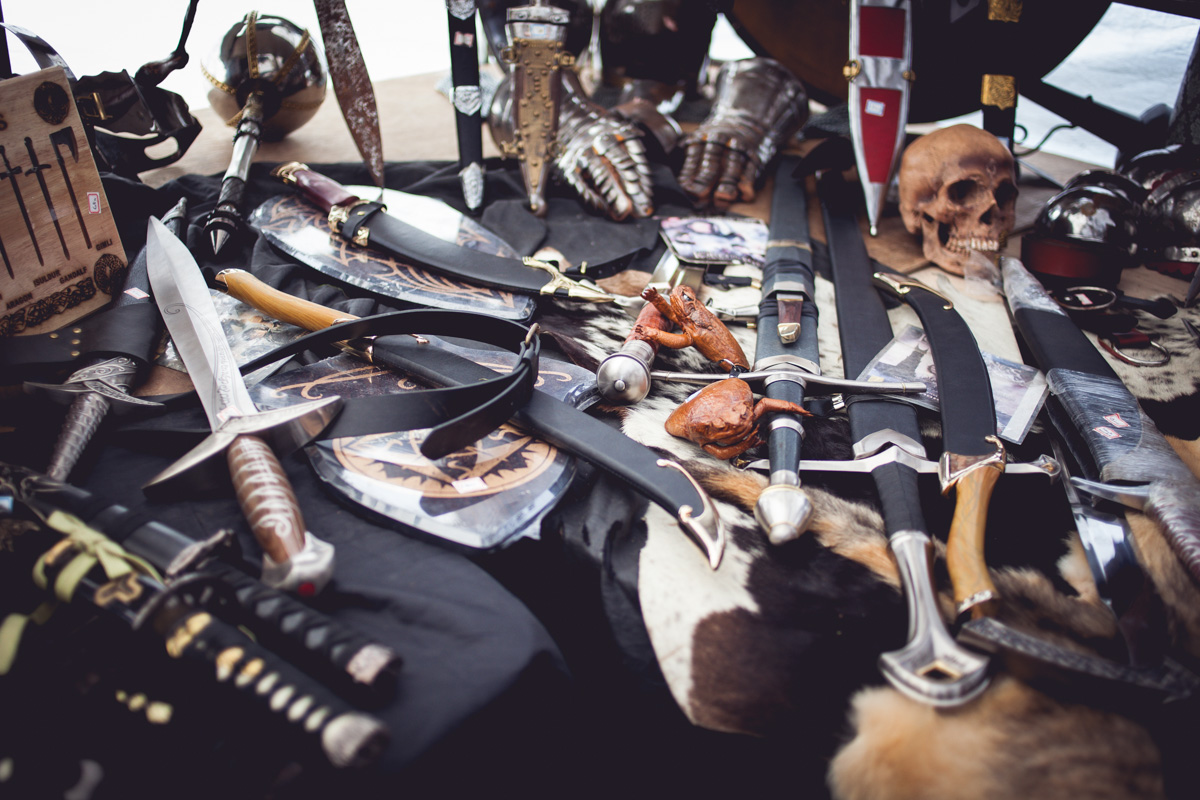 Found a guy selling Lord of The Rings weapons at a flea market in Oslo. Notice the small frog wallets on the table. They are made of real frogs. Ugh.