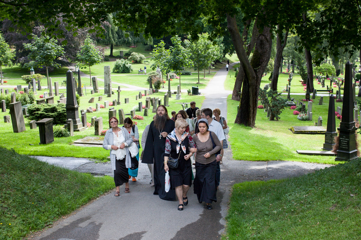 A group of Russian orthodox christians walking through  Vår Frelsers Gravlund  in Oslo. A graveyard where many famous Norwegians are buried, including Edvard Munch, Henrik Ibsen and Arnulf Øverland.