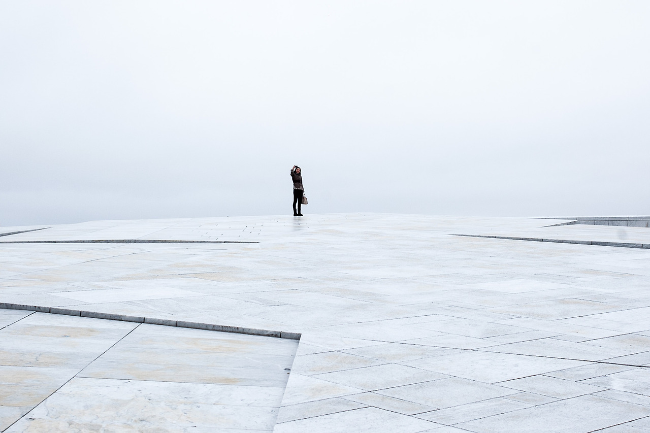 A tourist taking a selfie at the opera house in Oslo.