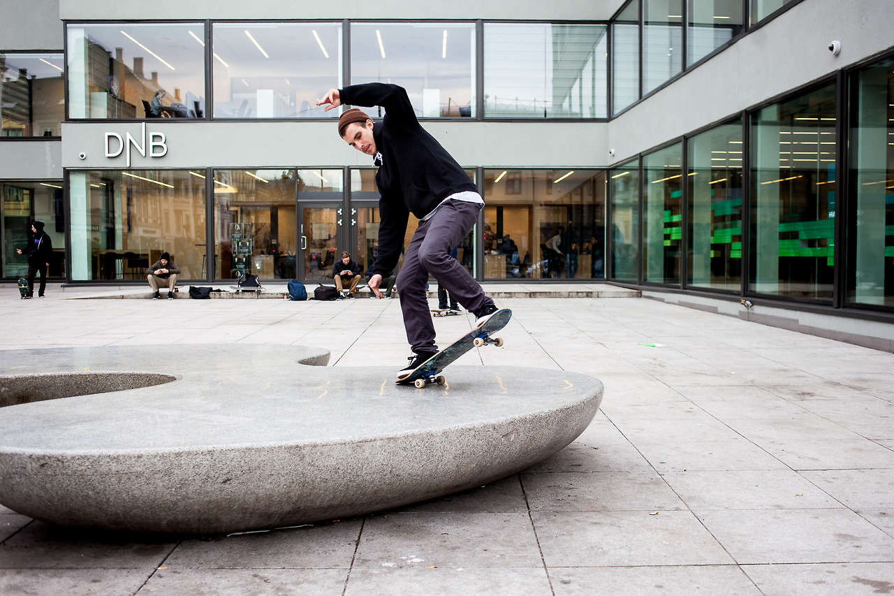 A skater outside of a Norwegian bank in Oslo.
