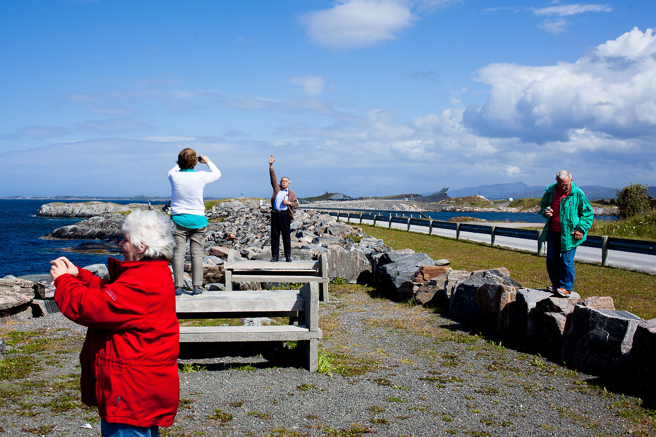 Tourists photographing each other at  Atlanterhavsveien  in Norway.