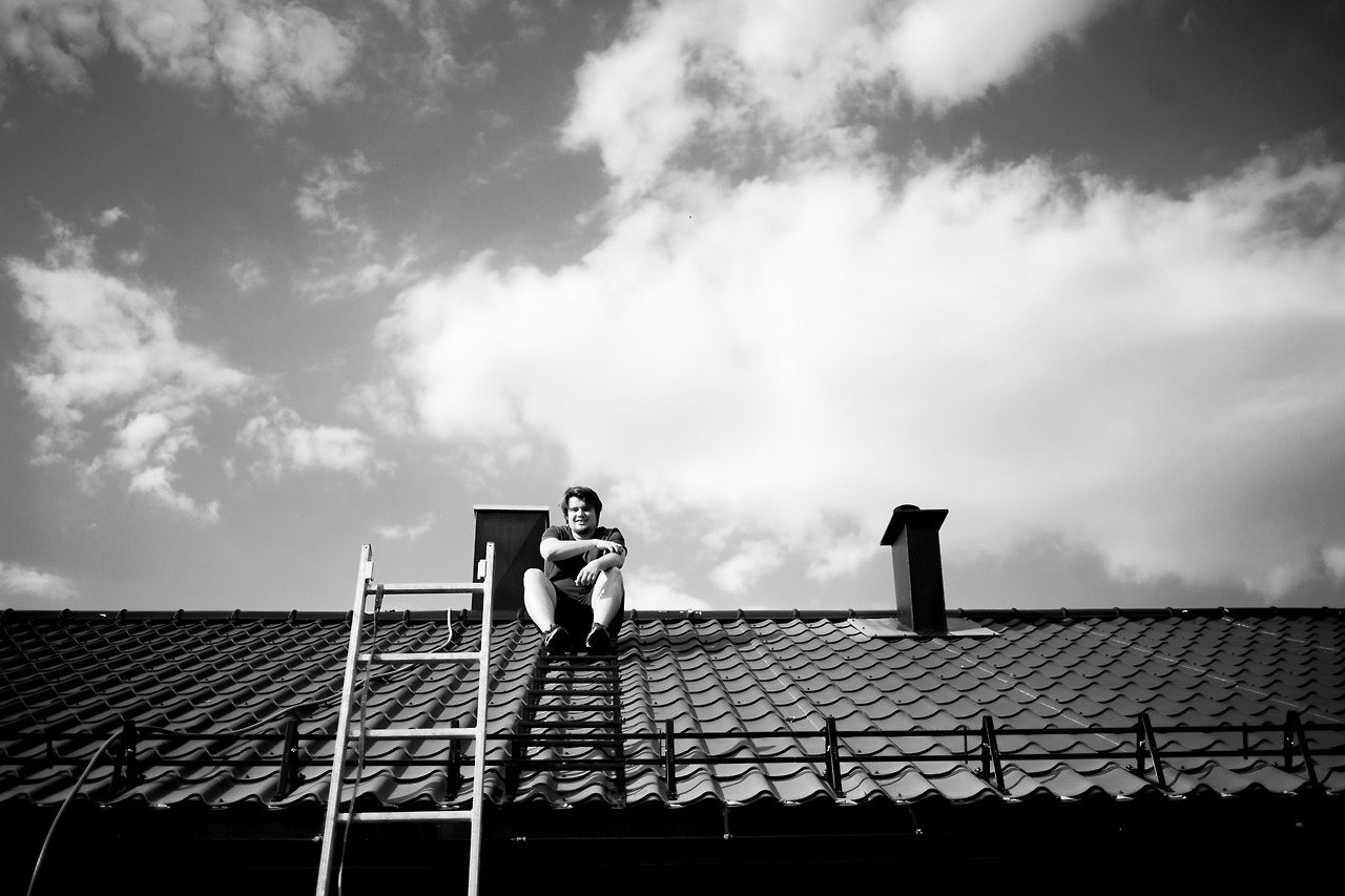 My friend  Eskil , climbing the roof of his house on his 24th birthday.