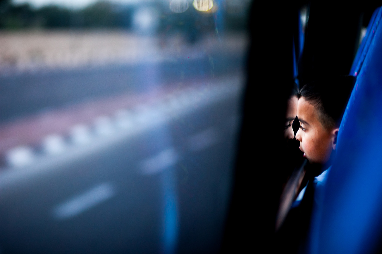 A child on the bus to Jerusalem, just after passing the checkpoint in Betlehem.