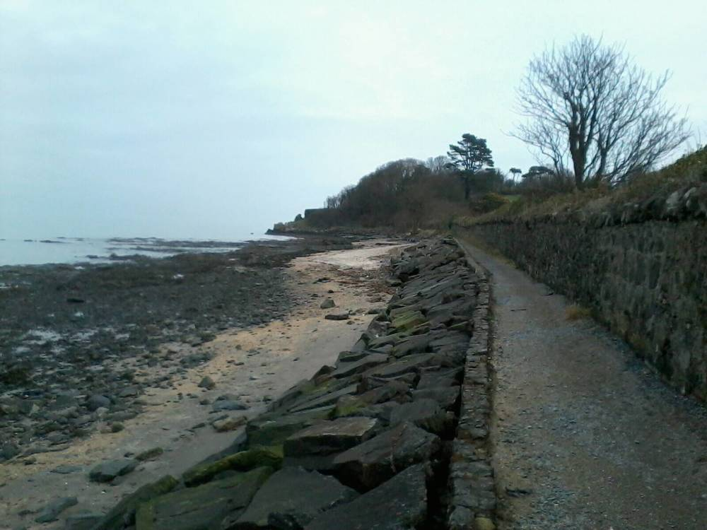 walking along the Belfast Lough looking out to St Helen's Bay