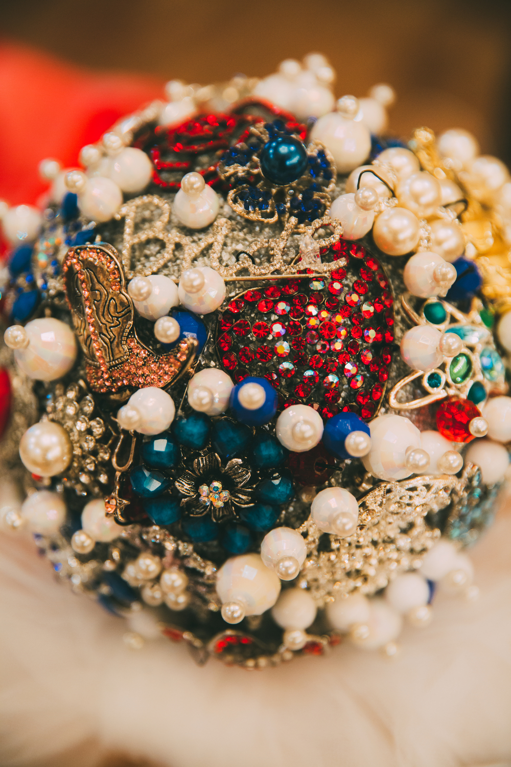 The bride's brooch bouquet included family heirlooms and gifts from loved ones.