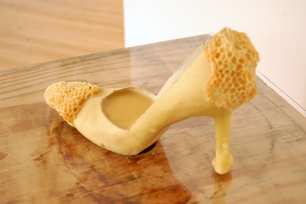 "Aganetha Dyck, Cinderella's Other Shoe, Found Object, Beeswax, Honeycomb, 10"" x 3"" x 7"""