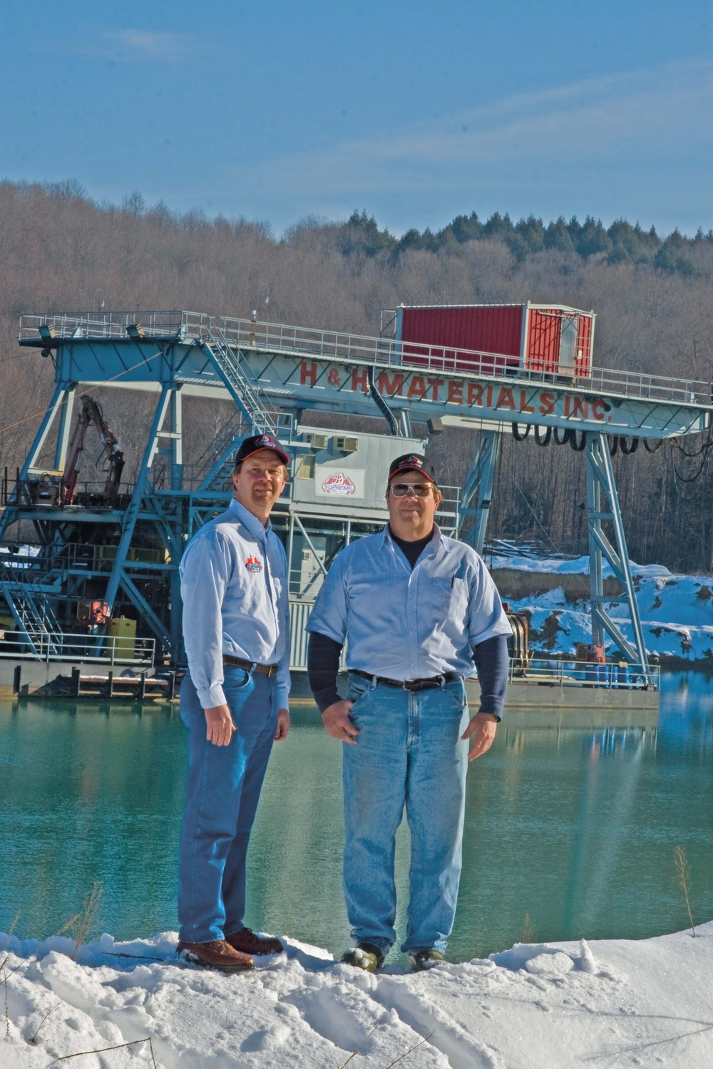 David and Neil Hoobler in front of the H & H Dredge
