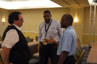 CAPTION: From left, Carlos Martinez, chief technology officer of the the Latin American and Caribbean Internet Addresses Registry (LACNIC), Stephen Lee, programme manager of the Caribbean Network Operators Group (CaribNOG) and Bevil Wooding, Caribnog executive director share a light moment on the opening day of Caribnog8-Lacnic Caribbean 6, which is being held at the Hilton in Willemstad, Curacao from September 29 to October 3. Photo: Gerard Best
