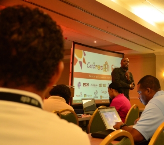 CAPTION:     Junior Mc Intyre, head of Caribbean Telecommunications Union's Caribbean Regional Communications Infrastructure Program coordination unit, addresses regional tech experts during CaribNOG 8, Hilton Curacao, Willemstad, October 1. PHOTO: GERARD BEST