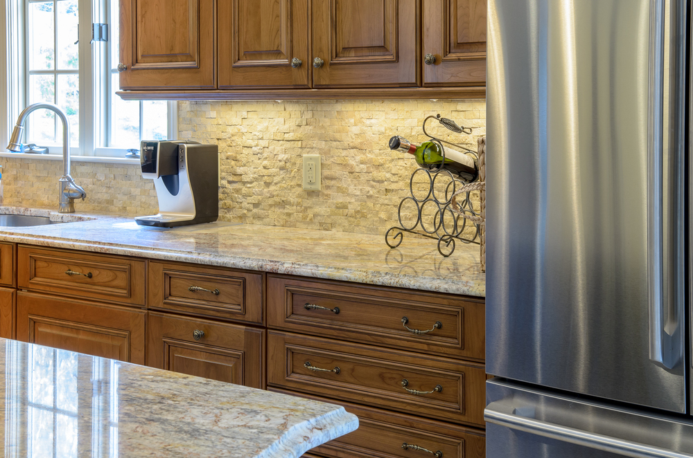 Accent lighting highlights the the texture of this beautiful backsplash.