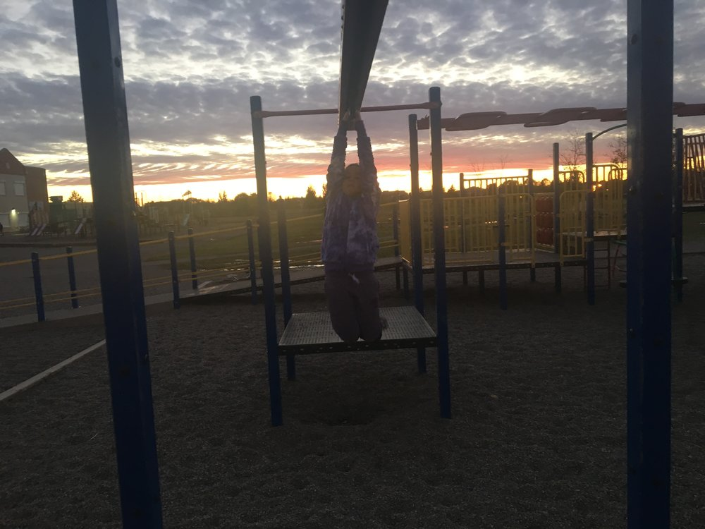 A little sunset climb on the playground bars