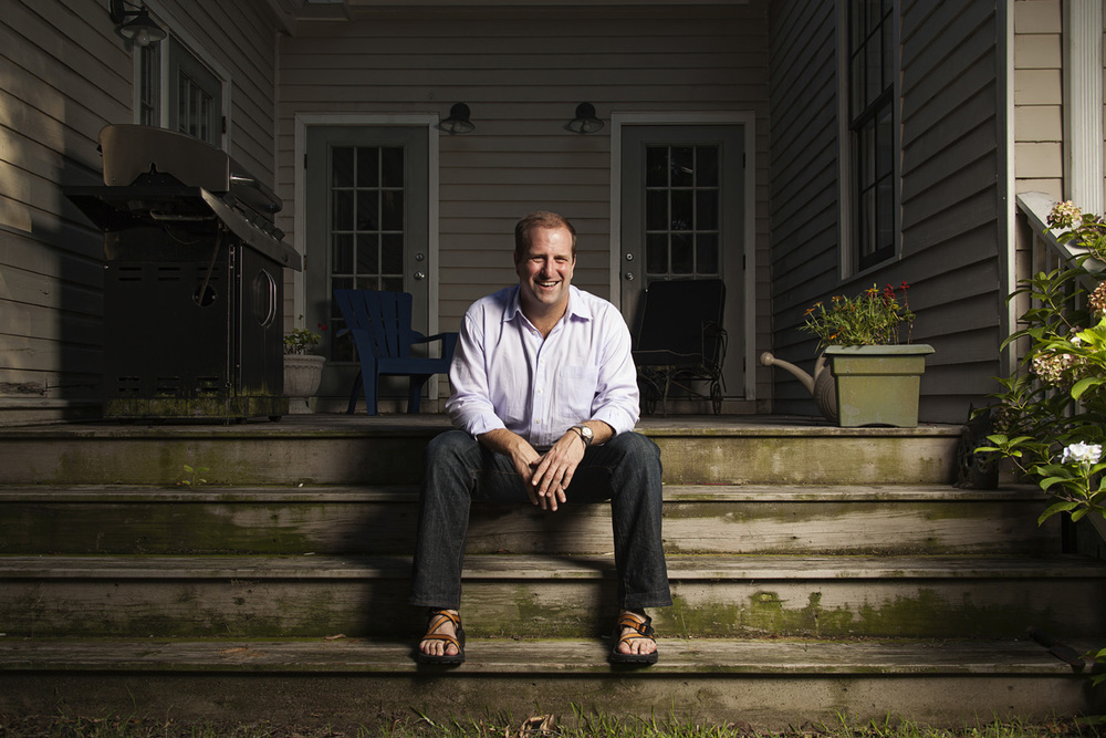 Kinnon sitting on wood steps outside of MIdtown Mobile, AL home | Todd Douglas Photography