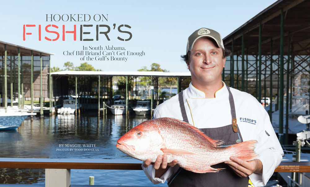 Chef Bill Briand holds the Snapper he is about to cook for the shoot.