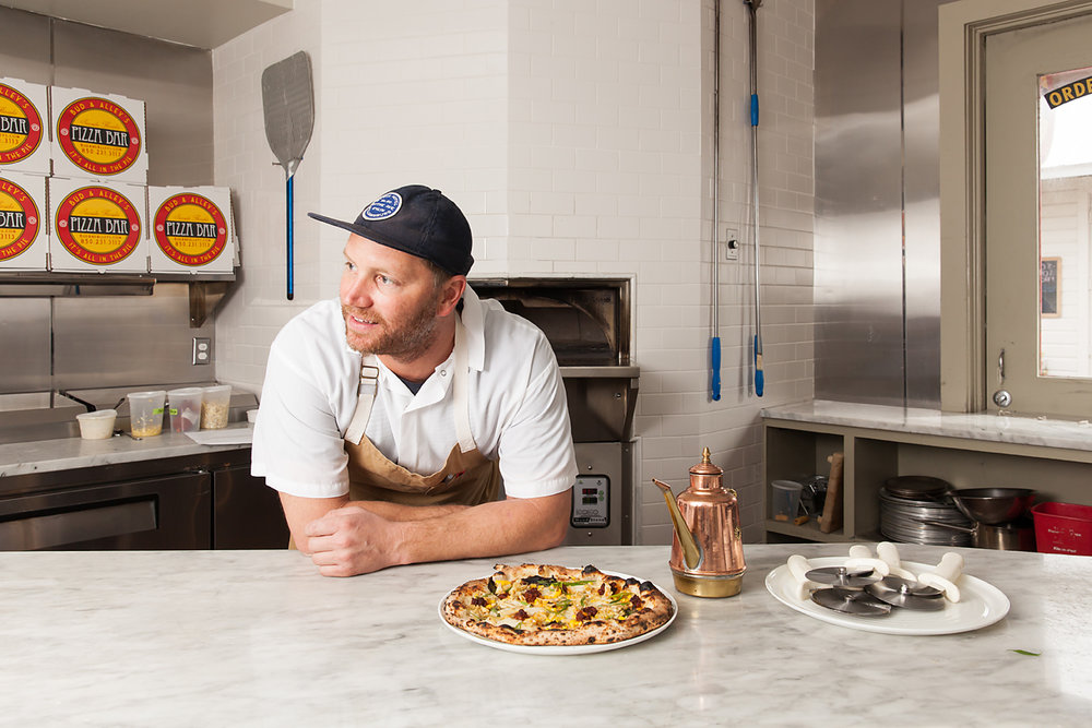 Chef Phillip McDonald near the pizza oven at Bud & Alley's Pizza Bar in Seaside, Florida.
