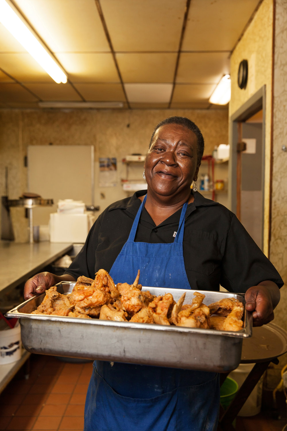 Mrs. Dorothy presents a fresh batch of friend chicken at Mama Lou's Restaurant in Robertsdale, Alabama.