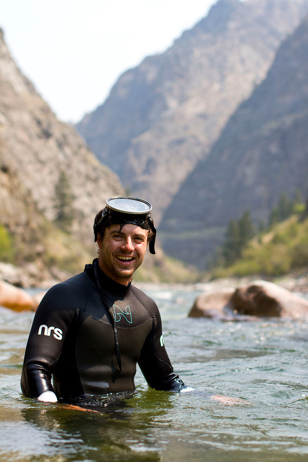 Six year Middle Fork guide, Kyle Smith holds steady for a portrait before continuing to snorkel around Redside Rapid.