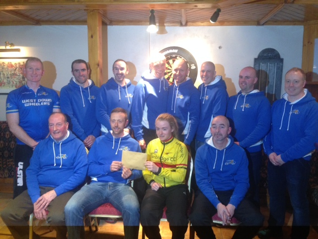 Shenna receives a donation from the members of West Down Wheelers