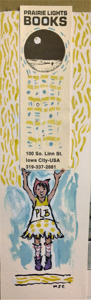 Kitten Hat Girl supports Prairie Lights, her local independent bookstore. Shown with a bookmark from Prairie Lights early days on Linn Street.