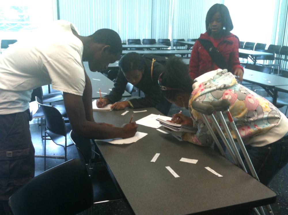 Students doing a problem scavenger hunt.