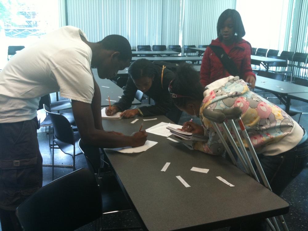 students complete a problem scavenger hunt
