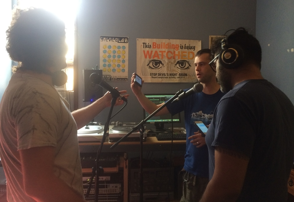 DJs Adam + Angel work with Zack to Record voice overs for their radio show