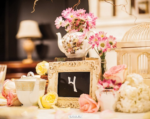 Vintage birdcage, tea pot and picture frame from Chicago Vintage Weddings