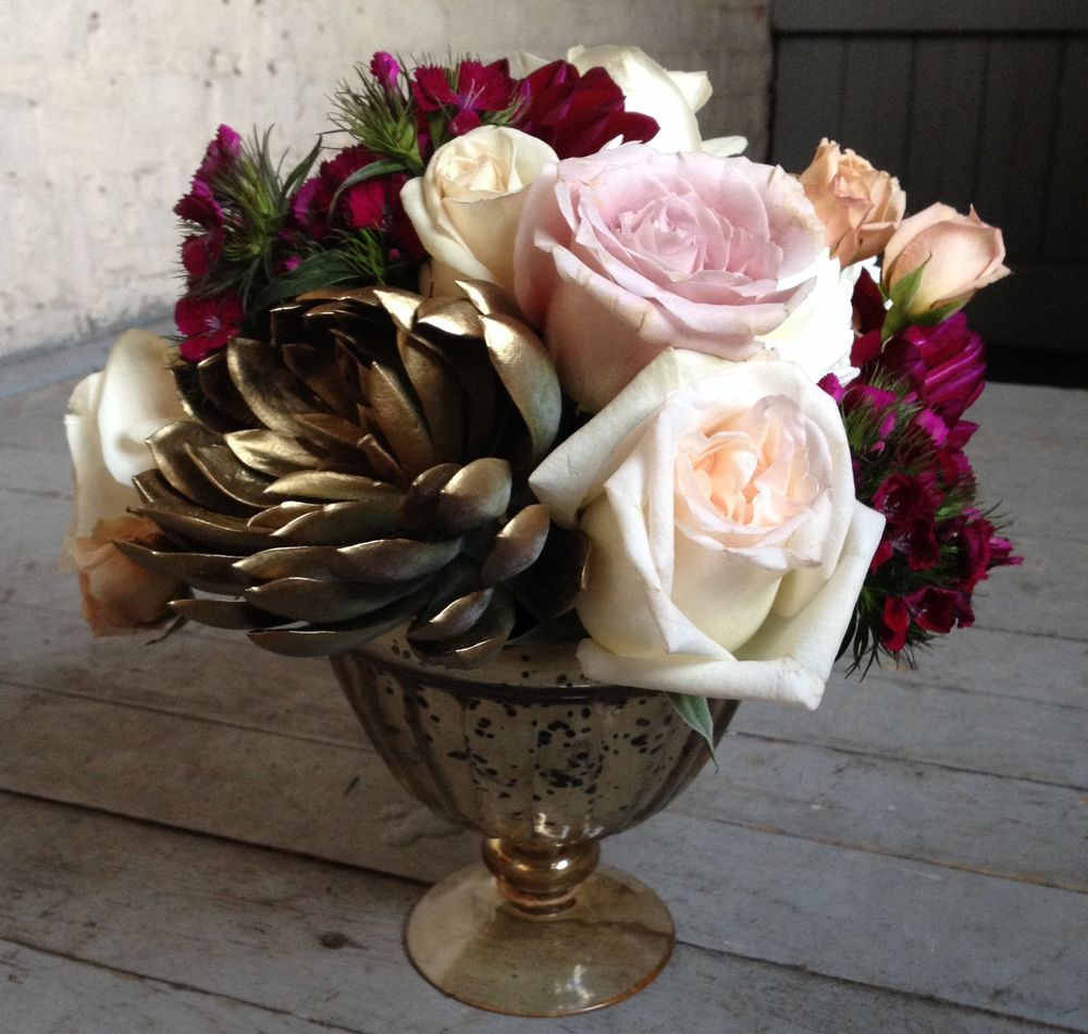 "Notice the gold ""flower""...it's not a flower but a gold spray painted succulent plant.  Cool, huh?  The vase is also vintage inspired gold.  The inspiration for the flowers  (and this blog post!) came from creative director,  Megan Moran of  City Girl Weddings ."