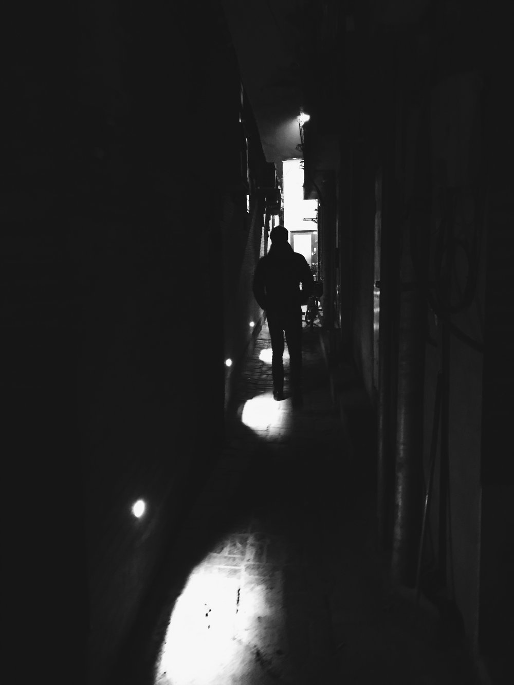 The shoulder width alley to The Orchid Hotel at Night.