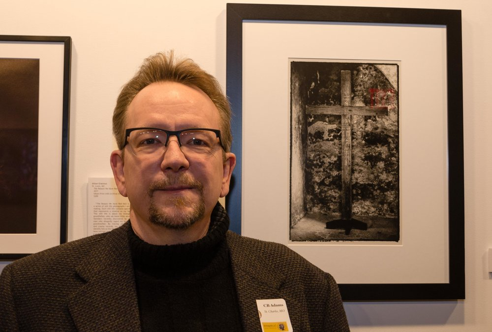 "CB Adams at the opening of ""Symbolic"" exhibition at Art Saint Louis. The silver gelatin photograph, ""Concepcion"" is available for purchase, $275 at the gallery."