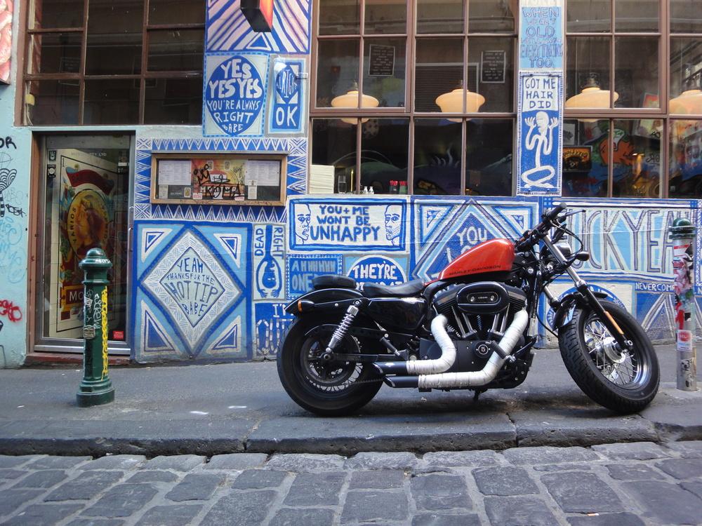 A motorbike outside Movida on Hosier Lane in Melbourne, Australia.