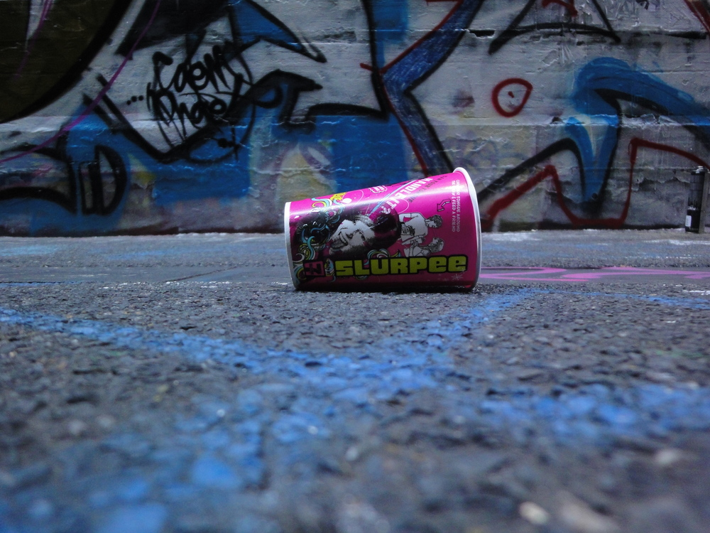 A discarded slurpee cup on Union Lane in Melbourne, Australia.