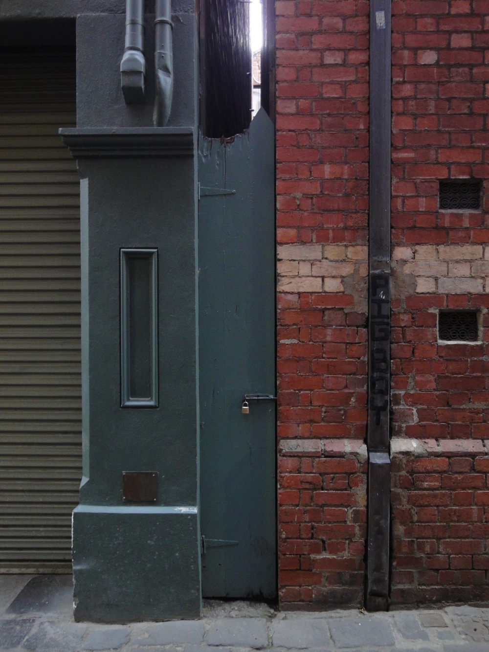A clever doorway on Hardware Lane in Melbourne, Australia.