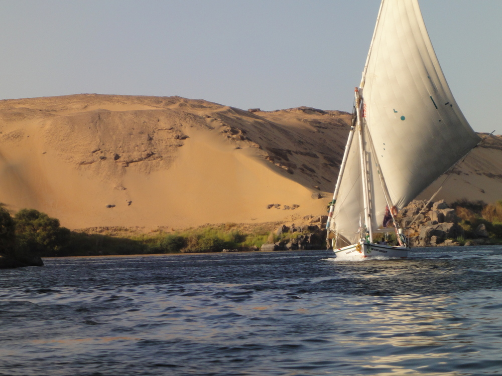 A traditional felucca floats along The Nile in Aswan, Egypt.