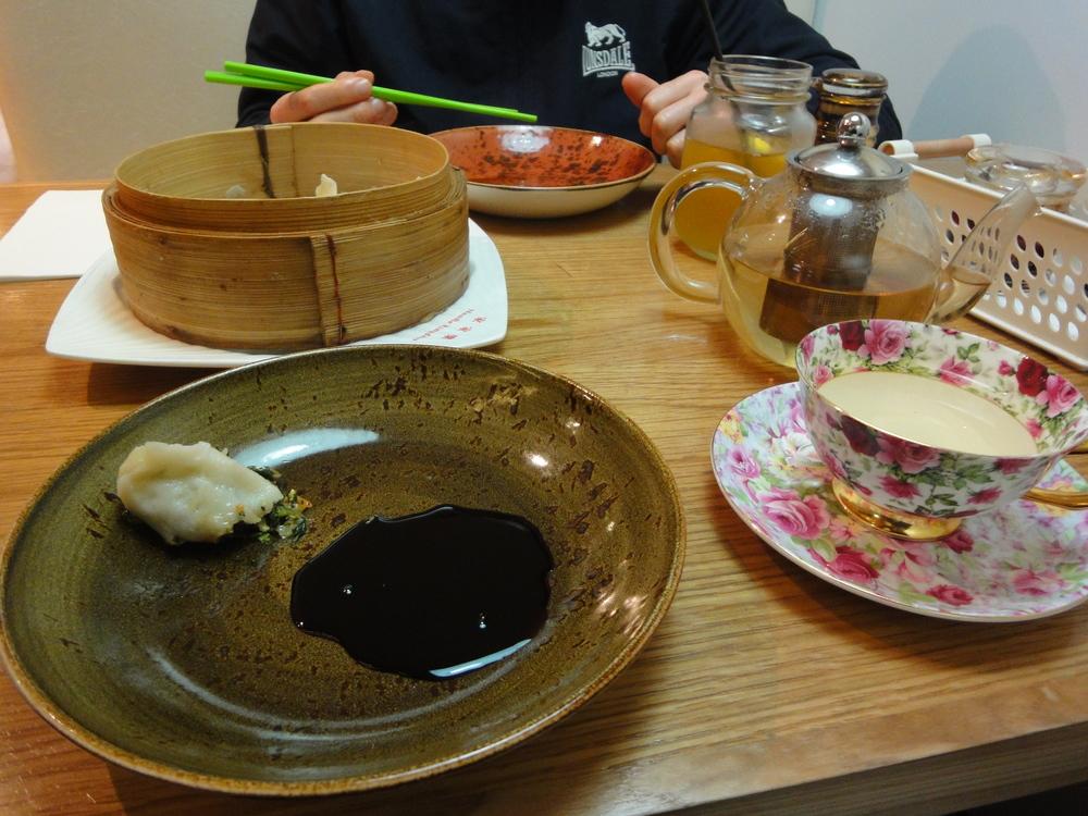 Enjoying a bamboo basket of steamed dumplings.