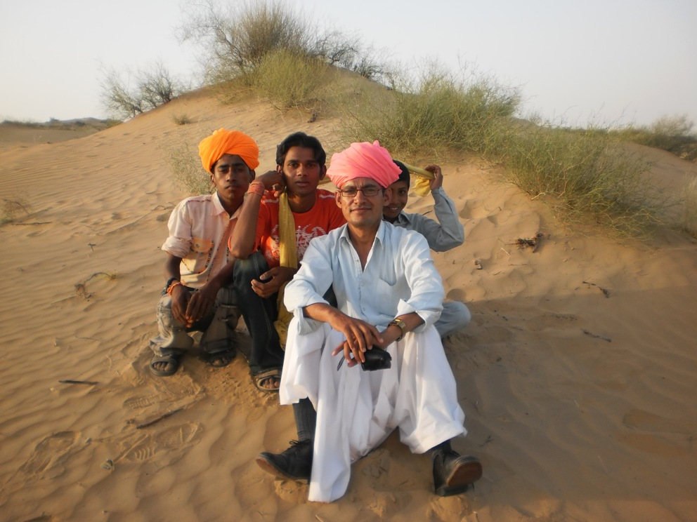 Villagers enjoying time in the sand dunes with Ashok. Photo credit: Ashok Bishnoi
