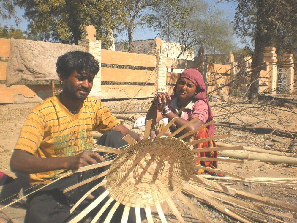 Thar Desert men and women weaving bamboo baskets. Photo credit: Ashok Bishnoi