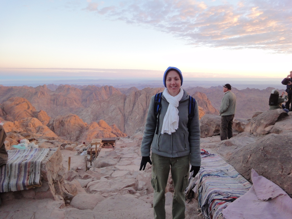 Me greeting sunrise at the summit of Mount Sinai in Egypt.
