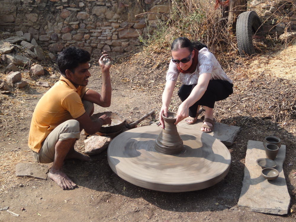 Me participating in some local pottery in Tordi, India. Check out that muscly left arm of mine!