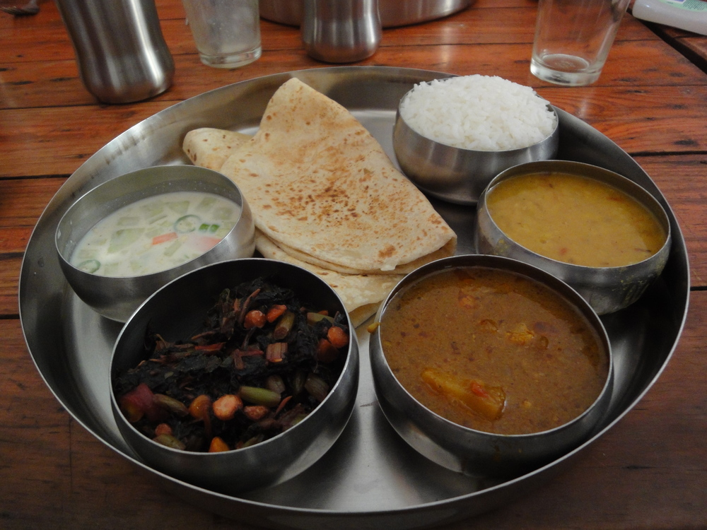 An Indian thali is best enjoyed when eaten with your hand.