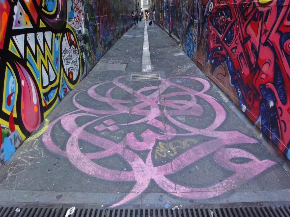 eL Seed's calligraffiti adorns the entrance ofone of Melbourne's street art laneways.