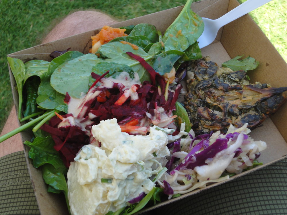 Incredible leafy salads, vegan quiche and potato salad (those hairy legs are my husband's!)