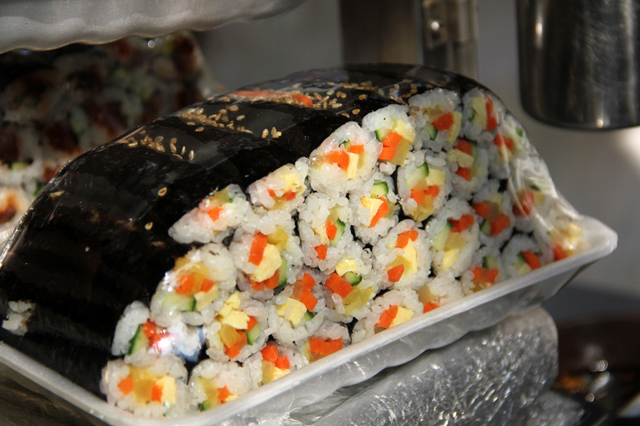 Gimbap or sushi rolls. Image taken from  here . Credits to the respective owner.