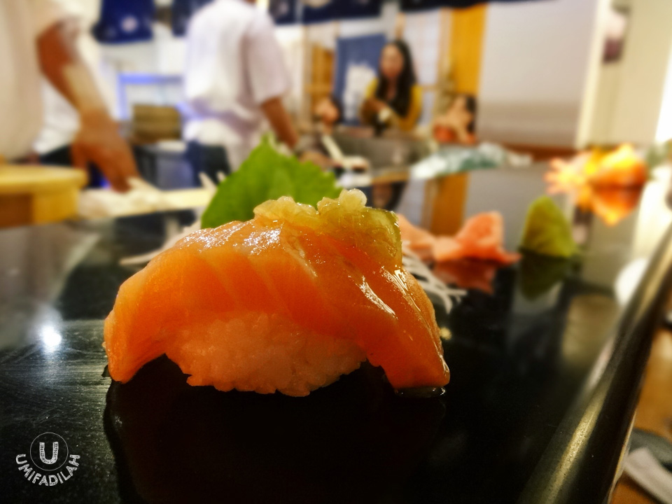 "Just when I thought it was just ""another salmon sushi"", I kept getting surprises. Never thought that salmon with a dash of goma (sesame) and goma oil on top could bring out its maximum flavor! It just works... really well. Perfect combination."