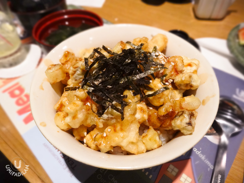 Tori Tenbara.  Rice bowl topped with tempura of small chicken cubes and mushroom, with white sesame & nori on top. By the time it came to our table, the tempuras weren't crunchy anymore, in fact, already soaked up in its sweet Tendon sauce, so yeah.. just your regular rice bowl.