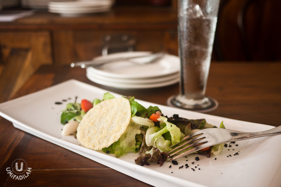 Signature Salad (IDR 39k):  Mesclun mix, aged balsamic reduction,  cherry tomatoes, olive soils, parmigiano reggiano disc.