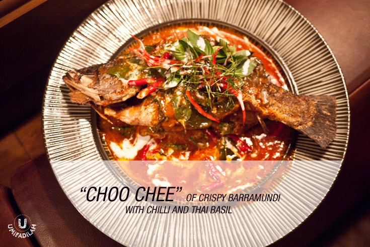 """Choo Chee"" of Crispy Barramundi with Chilli and Thai Basil (IDR 170k).   Choo Chee is basically red curry, cooked in high heat until the curry gets really hot that it literally makes ""choooo cheeee"" sound. Fresh Barramundi is deep-fried until golden crisp, then red sauce is being poured with addition of chili & Thai basil. Despite the fiery red color, it's actually not that hot (the previous soup was far hotter than this) – in fact, there's a slight hint of sweetness and the much-added creamy coconut milk just tone down the flavor to a milder one. You're advised to eat them with Thai Jasmine Rice (which is super fragrant BTW), or Roti Canai. Damn delicious!"