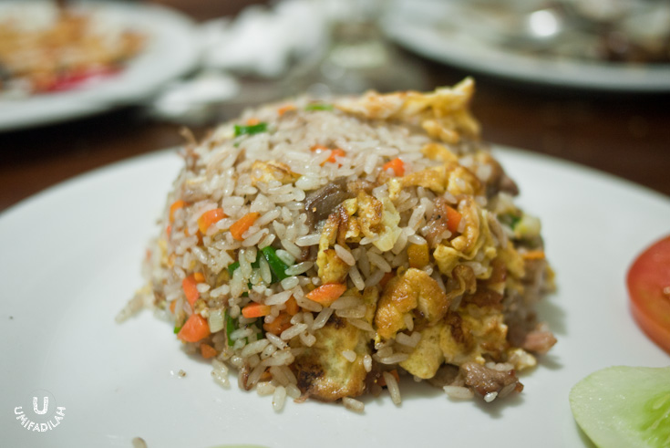 """Nasi Goreng Daging Kambing"" / Fried rice with Mutton – IDR 30.000. This nutritious Xinjiang fried rice, or ""Polu""/pilaf as the Uyghurs call it, is basically fried rice cooked with vegetable (mainly carrots and spring onions), with eggs and mutton meat. It's tasty, but if you had to ask me, I still prefer our very own Nasi Kebuli that has more spices into it."