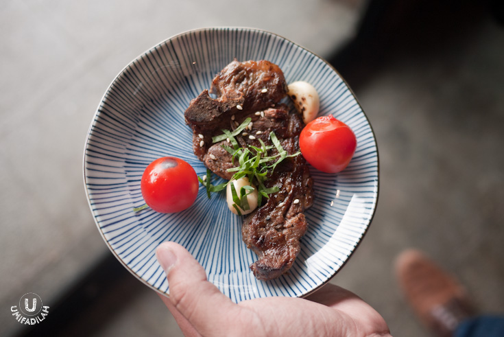 Ramu Yaki (Lamb Chop) – IDR 69.000,  served with cherry tomatoes, grilled garlic, and chopped mitsuba leaves.   For less price comes smaller chunk of meat. Still, I'd recommend the shoulder for a better eating experience.