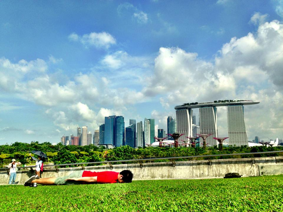 Somewhere in Singapore, with the background of blue sky and Marina Bay Sands.
